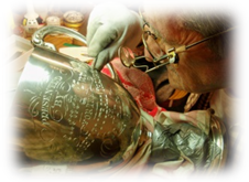 A Hand engrager at work on a Silver Trophy. This is the traditional way of engraving using a graver or burin.
