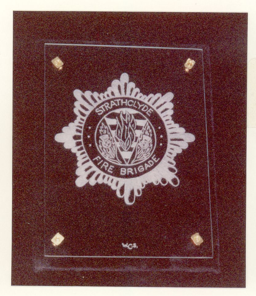 Strathclyde Fire Service. A Hand engraving on flat glass of the badge of the Strathclyde Fire Service Completed as a Practice piece.
