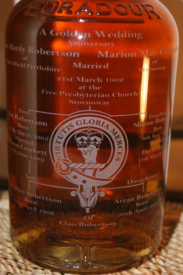 A Bottle of whisky engraved with a Clan Robertson Badge and the Family Tree of a couple celebrating their Golden Wedding Anniversary.