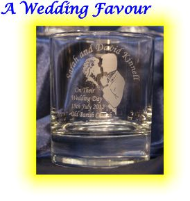 This is a plain whisky glass engraved with a bride and groom. It also has engraved onto the their name and details of the ceramony. These engraved glasses were given to male guests at the wedding reception.
