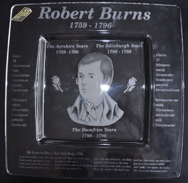 This is a square crystal plate engraved with a photograph of Robert Burns in the center and some of his poetry engraved around the edges. These depict his Ayrshire years, Edinburgh years and his Dumfries years.